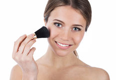 Smiling beauty with makeup brush Royalty Free Stock Photography