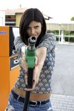 Smiling beauty pointing special gasoline gun fun Royalty Free Stock Images