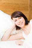 Smiling in bed stock images