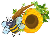 A smiling bee near the big beehive Stock Photo