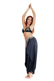 Smiling belly-dancer. Belly-dancer with long red hair posing in oriental costume Royalty Free Stock Photography