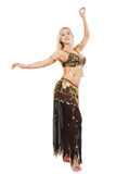 Smiling bellydancer. Beautiful blond bellydancer posing in black and golden costume Stock Image