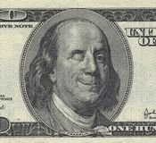 Smiling Ben Franklin. With Wink. US dollar royalty free stock photo