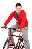 A smiling bicyclist on a bicycle posing stock photos