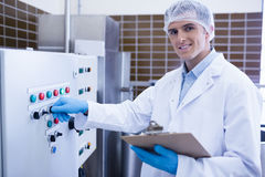 Smiling biologist using the machine Stock Images
