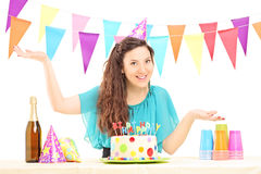 A smiling birthday female with a party hat posing Stock Photography