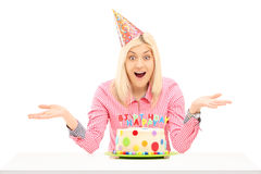 Smiling birthday female wearing party hat and gesturing Stock Photos