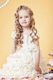 Smiling birthday girl posing with tasty cake Stock Photography