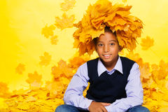 Smiling black boy wearing maple leaves wreath Royalty Free Stock Photos