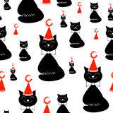 Smiling black cat with Christmas hat seamless pattern Royalty Free Stock Images