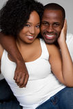 Smiling Black Couple. Happy casual black couple smiling royalty free stock image