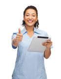 Smiling black doctor or nurse with tablet pc. Healthcare, technology and medicine concept - smiling female african american doctor or nurse tablet pc computer Stock Photography