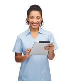 Smiling black doctor or nurse with tablet pc. Healthcare, technology and medicine concept - smiling female african american doctor or nurse with tablet pc Stock Images