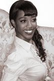 Smiling black girl portrait - retro style (sepia). Portrait of happy Afro-American young woman in 50s-60s retro style - monochrome image is sepia toned Royalty Free Stock Photos