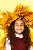 Smiling black girl wearing maple leaves wreath Stock Image