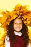 Smiling black girl wearing maple leaves wreath Stock Image