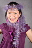 Smiling black hair girl in violet dress Stock Photo