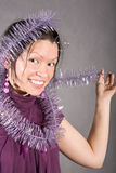 Smiling black hair girl in violet dress Royalty Free Stock Photography