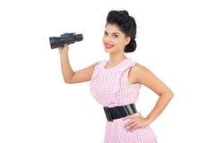 Smiling black hair model holding binoculars Royalty Free Stock Photos