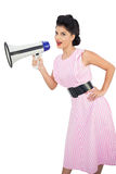 Smiling black hair model holding a megaphone Stock Images