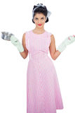 Smiling black hair model holding a pan and wearing rubber gloves Royalty Free Stock Photos