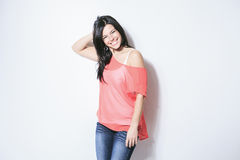Smiling black hair woman on grey background Royalty Free Stock Photos