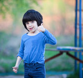 Smiling black-haired boy Royalty Free Stock Images