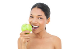 Smiling black haired model holding green apple Stock Images