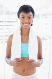 Smiling black haired woman wearing a towel around her neck Royalty Free Stock Photo