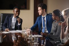 Black male boss talking to business team in conference room. Smiling black male boss talking to business team in conference room Royalty Free Stock Photography