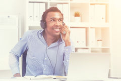 Smiling black man listening to music, toned Royalty Free Stock Photography