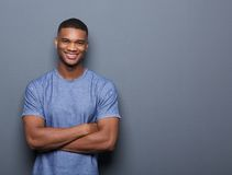 Smiling black man posing with arms crossed Stock Images