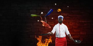 Black chef creative cooking. Mixed media. stock images