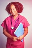 Smiling Black Nurse. Holding folder Stock Photography