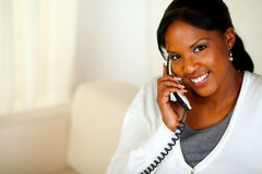 Smiling black woman looking at you while talking Stock Images