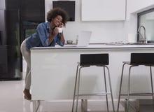 Smiling black woman in modern kitchen Royalty Free Stock Photos