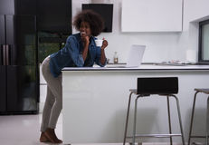 Smiling black woman in modern kitchen Royalty Free Stock Images