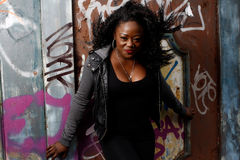 Smiling Black Woman Posing at Wall with Vandals Stock Photography