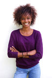 Smiling black woman standing against white background Stock Image