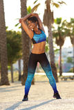 Smiling black woman stretching workout outside Royalty Free Stock Photography