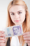 Smiling blond beauty woman holds against banknote Stock Image