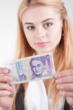 Smiling blond beauty woman holds against banknote Stock Photos