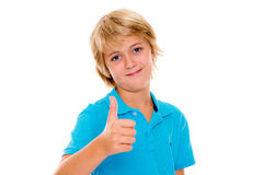 Smiling blond boy with thumb up Stock Photography