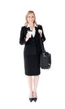 Smiling blond businesswoman with coffee and bag Stock Images
