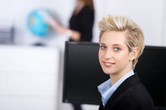 Smiling Blond Businesswoman In Office Royalty Free Stock Images