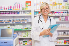Smiling blond doctor holding documents Royalty Free Stock Images