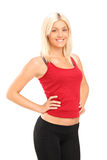 A smiling blond female athlete posing. Isolated against white background Royalty Free Stock Photo