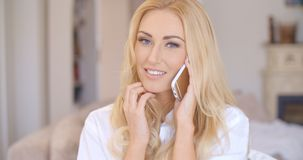 Smiling Blond Female Talking through Phone Stock Images