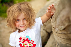 Smiling blond girl. Girl with blue eyes smiling and looking straight to the camera stock photos