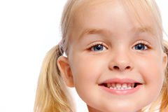 Smiling blond girl. Pretty little girl smiles for portrait, isolated on white stock images